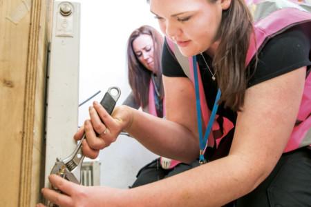 Student fitting a radiator valve