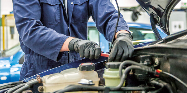 Motor Vehicle student working on the engine of a vehicle