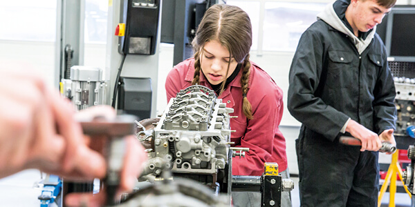 Motor Vehicle student working on an engine component