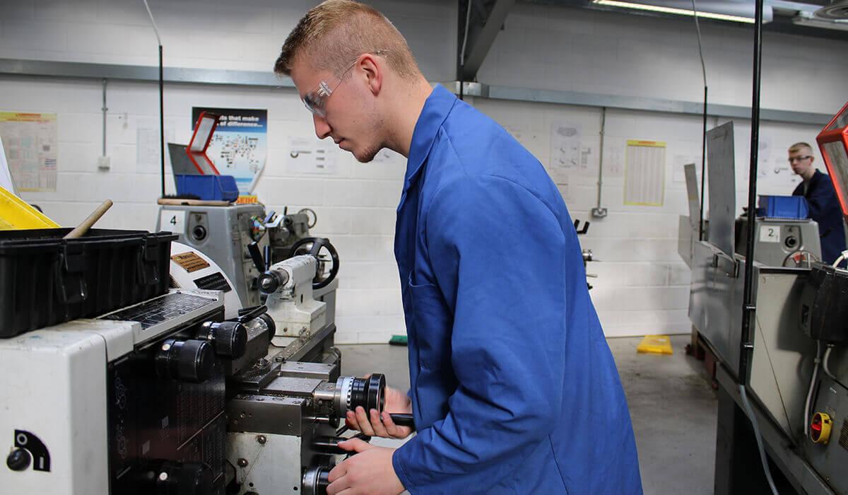 Student using engineering machinery