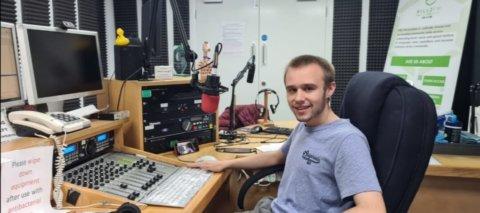 Conor Sturmey in a radio studio
