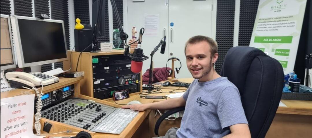 Learner Conor Sturmey in a radio studio