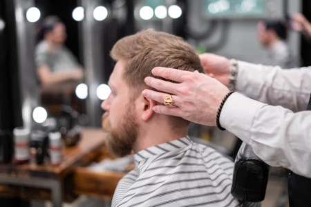 Customer sitting in Barber chair